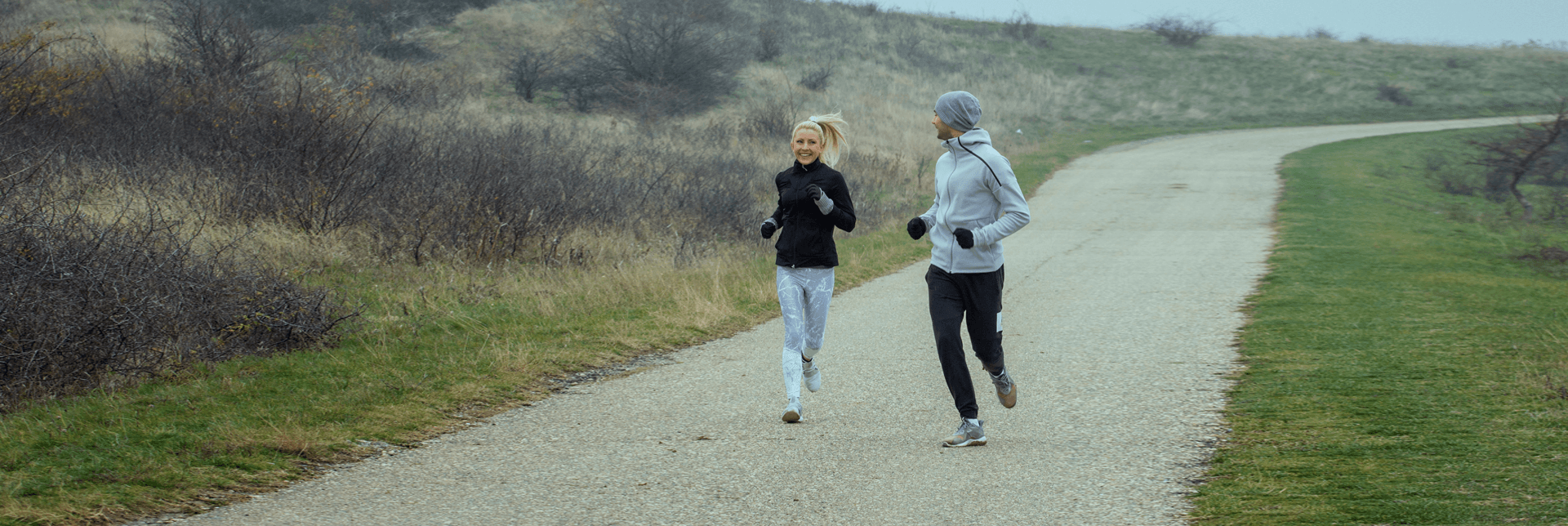 Couple running outdoors during winter