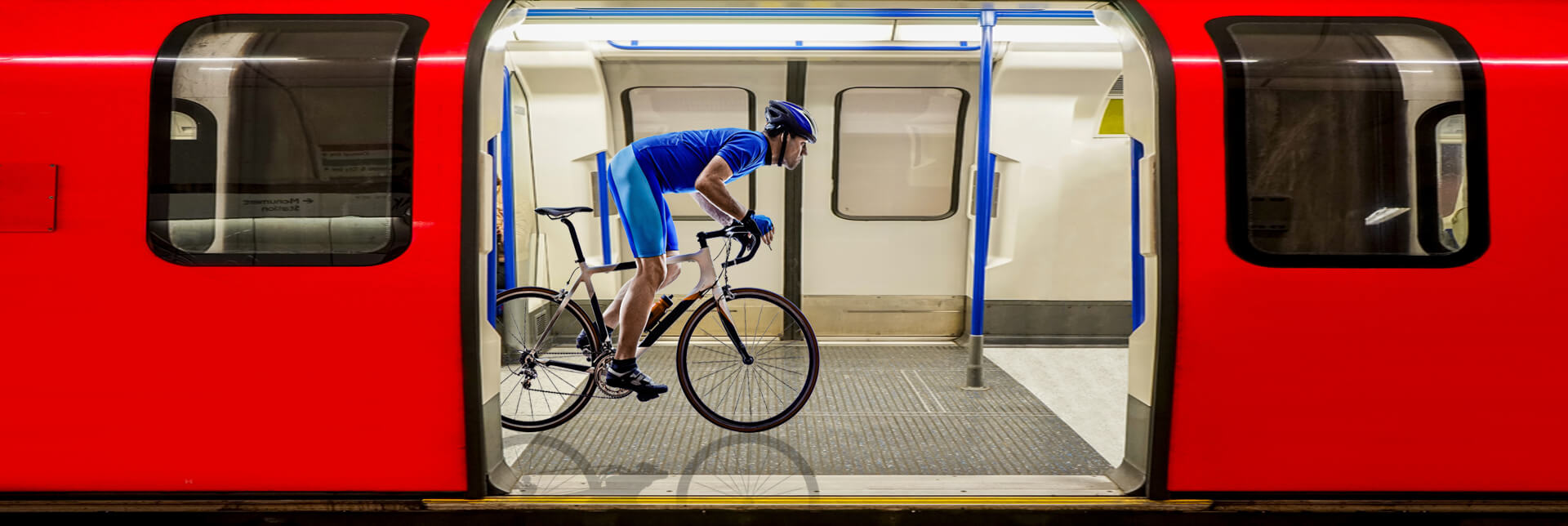 Cycle the London underground. Cyclist on a London Tube Train.