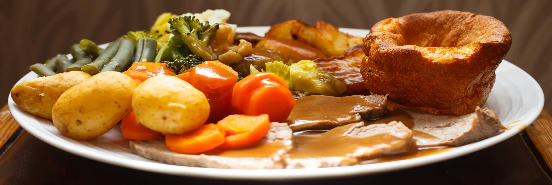 Roast dinner plate full of food